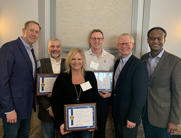 Lifetime Service Award presented to three bankers