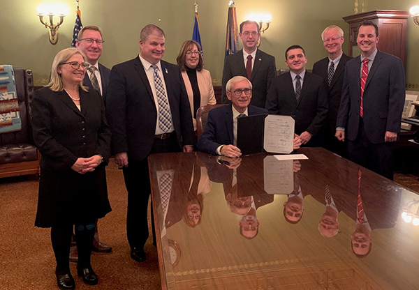 SB 457 is signed into law.