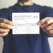 Person holding Covid 19 Vaccination card